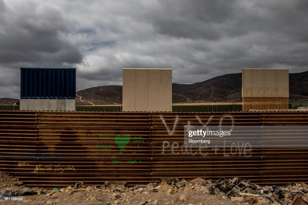 Prototypes for the new U.S. -Mexico border wall stands on display in Tijuana, Mexico, on Monday, May 21, 2018. 'We won't care about threats of a wall,' National Regeneration Movement Presidential candidate Andres Manuel Lopez Obrador announced, assuring another rally crowd in Zacatecas, one of the states that sends the most migrants to the U.S., that with him in power, they'll achieve equal footing with their neighbors to the north. Photographer: Alejandro Cegarra/Bloomberg via Getty Images