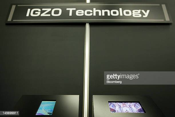 Prototypes of 49inch left and 61inch liquid crystal display screens based on the new indium gallium zinc oxide technology jointly developed by Sharp...