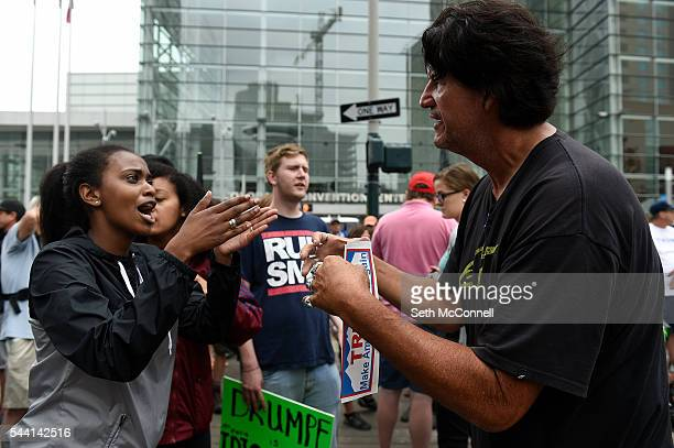 ProTrump and AntiTrump protestors argue during an AntiTrump rally at the corner of 14th and California in Denver Colorado on July 1 2016