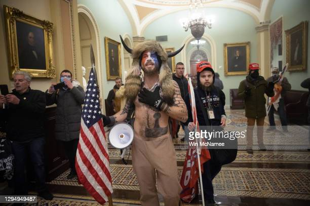 Pro-Trump mob confronts U.S. Capitol police outside the Senate chamber of the U.S. Capitol Building on January 06, 2021 in Washington, DC. Congress...