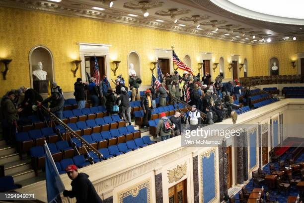 Pro-Trump mob gathers inside the Senate chamber in the U.S. Capitol after groups stormed the building on January 06, 2021 in Washington, DC. Congress...