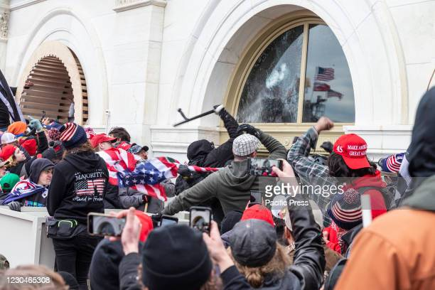 Pro-Trump protesters break windows of the Capitol building. Rioters broke windows and breached the Capitol building in an attempt to overthrow the...