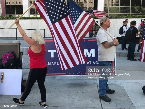 Pro-Trump protesters were already waving flags early Monday, May 1 outside the Federal Building in downtown Los Angeles, hours before tens of...