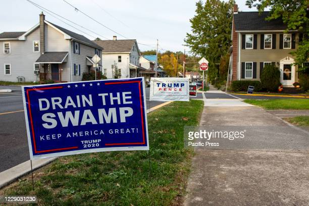 Pro-Trump signs are displayed along a street in Northumberland, Pennsylvania.