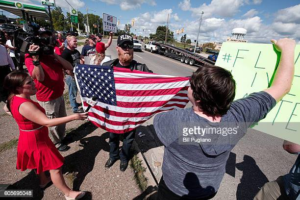 A proTrump supporter and an antiTrump protestor express they opinions to each other while waiting for Republican presidential nominee Donald Trump to...