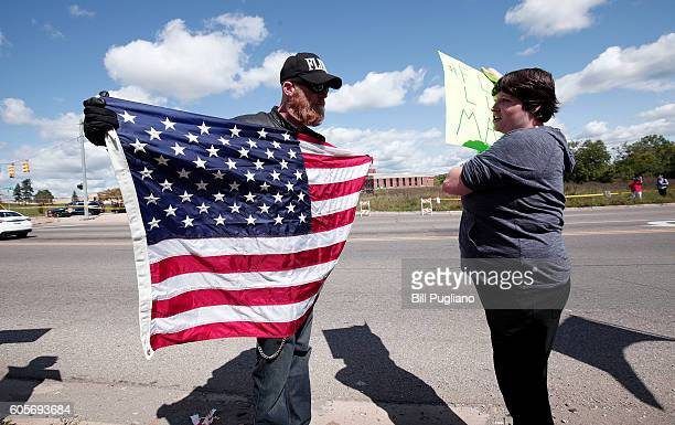 A proTrump supporter and an antiTrump protestor have a discussion while waiting for Republican presidential nominee Donald Trump to arrive for a tour...
