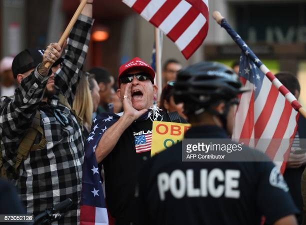 ProTrump supporters try to interrupt the Refuse Fascism group in Hollywood California on November 11 2017 during a protest calling for no 'Fire and...