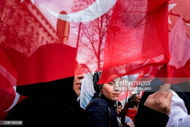 Pro-Turkey demonstrators wave Turkish flags in front of the Permanent Representation of Turkey to the European Union during a meeting between Turkish...