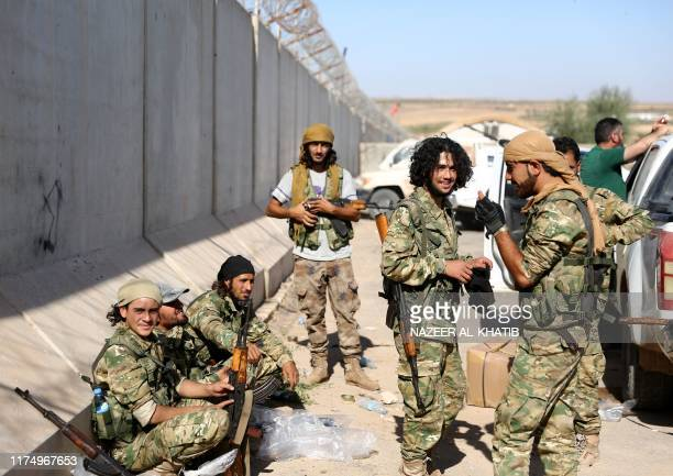 Pro-Turkish Syrian fighters gather near the town of Azaz in Syria's northern Aleppo province as they prepare to take part in an offensive against...