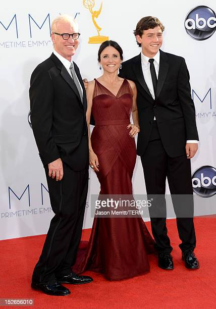 Proucer Brad Hall actress Julia LouisDreyfus and guest arrive at the 64th Primetime Emmy Awards at Nokia Theatre LA Live on September 23 2012 in Los...