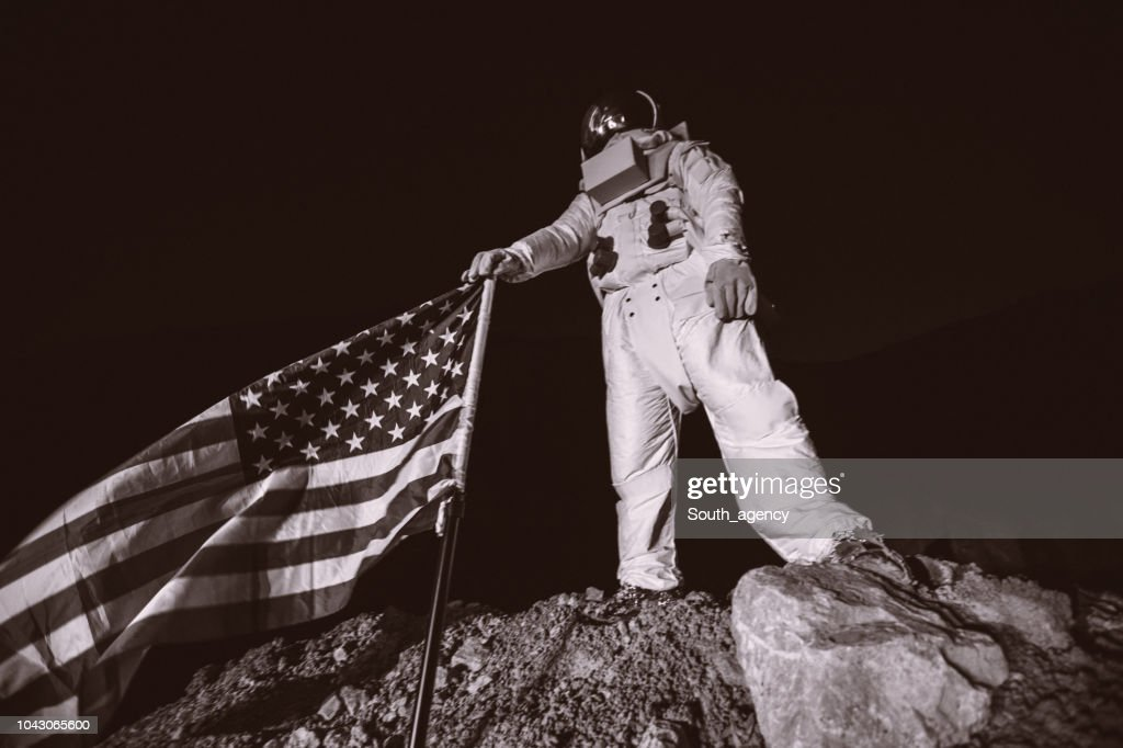 Proud American Astronaut Holding American Flag : Stock Photo