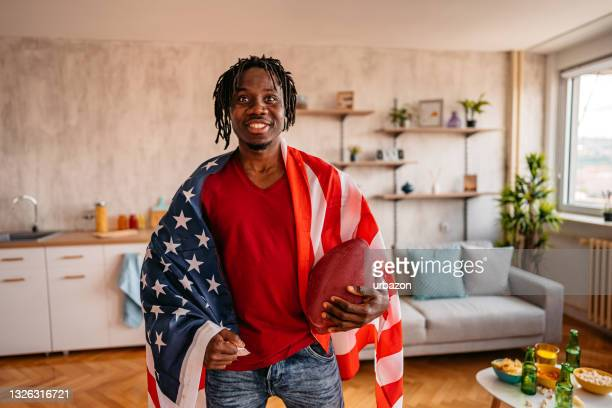 proud american football fan celebrating the win at home - world sports championship stock pictures, royalty-free photos & images