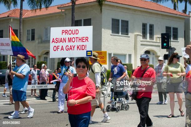proud asian mother of a gay son at the 2012 long beach lesbian & gay pride - united_states_house_of_representatives_elections_in_florida,_2012 stock pictures, royalty-free photos & images