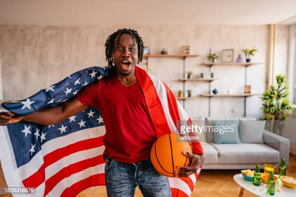 proud basketball fan celebrating the win at home - world sports championship stock pictures, royalty-free photos & images
