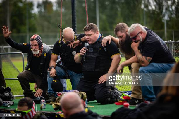 Proud Boy organizers lead in a prayer several hundred people gathered at Delta Park in Portland, Oregon on September 26, 2020. - Far-right group...