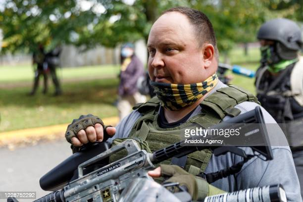 Proud Boy supporter carries a paintball rifle as the Proud Boys a rightwing proTrump group gather with their allies in a rally called âEnd Domestic...