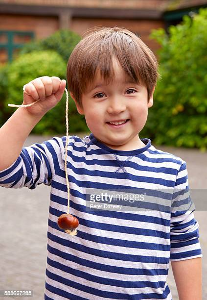 Proud boy with conker