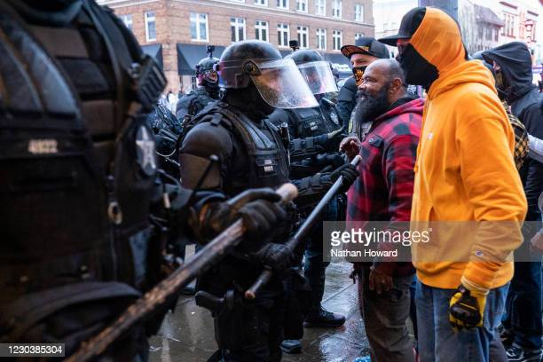 Proud Boys and other far-right protesters argue with police during a protest against COVID-19 restrictions on January 1, 2021 in Salem, Oregon....