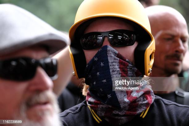 Proud Boys wait to get into vehicles to go to another location after marching across the Hawthorne Bridge in Portland Ore United States on August 17...