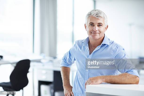 Proud businessman in his office