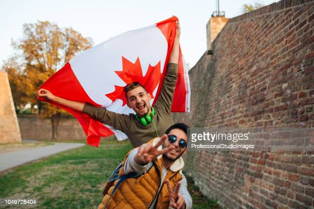 proud canadians - canadian flag stock pictures, royalty-free photos & images
