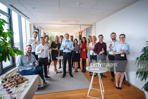 proud ceo posing with staff of new business - launch event stock pictures, royalty-free photos & images