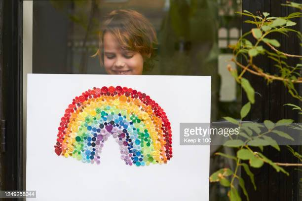 proud child holding and showing their art work - colors of rainbow in order stock pictures, royalty-free photos & images