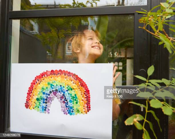 proud child holding and showing their art work - flatten the curve stock pictures, royalty-free photos & images