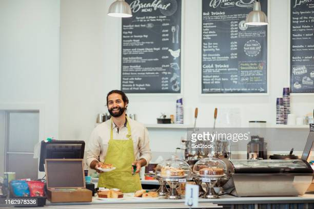 proud coffee shop worker - wide angle stock pictures, royalty-free photos & images