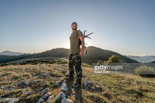 proud country man in the forest full length portrait - hunting stock pictures, royalty-free photos & images