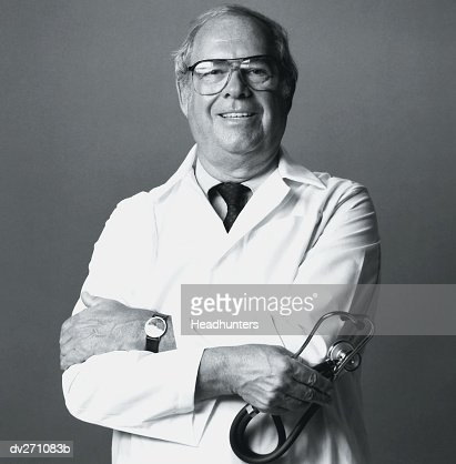 Proud Doctor With Stethoscope In Hand High-Res Stock Photo ...Doctor Stethoscope Comment