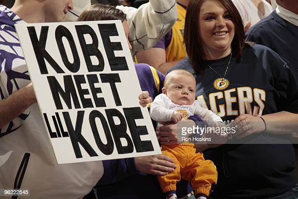 Proud father shows off his son to Kobe Bryant as the Los Angeles Lakers take on the Indiana Pacers at Conseco Fieldhouse on January 27, 2010 in...