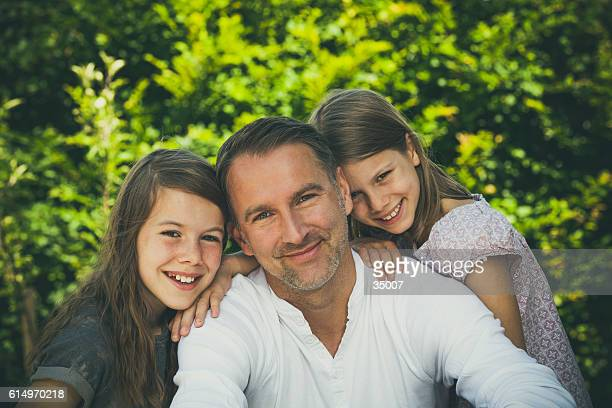 proud father with two daughters