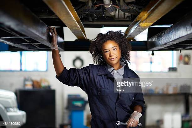 proud female garage mechanic .