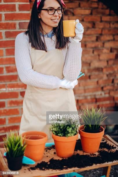 Proud gardener in her rooftop garden