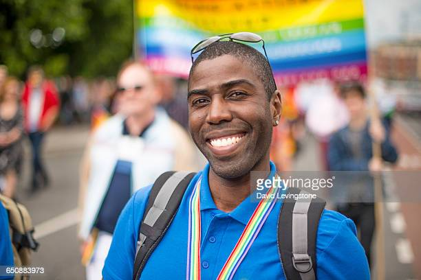 proud gay man during pride parade - lgbtq stock pictures, royalty-free photos & images