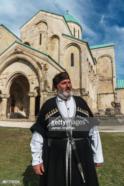 proud georgian man, in traditional cossack dress, outside bagrati cathedral, kutaisi, georgia (model release) - georgian culture stock pictures, royalty-free photos & images