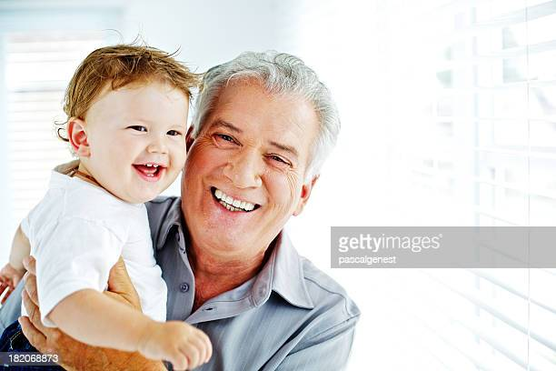 Proud grand-father and happy little son