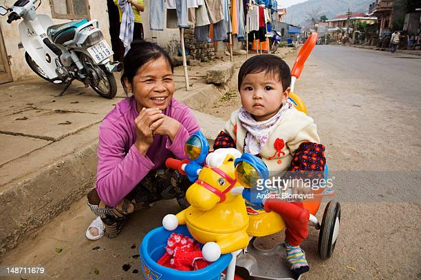 proud grandmother and child with colourful toys on main street. - chubby granny fotografías e imágenes de stock