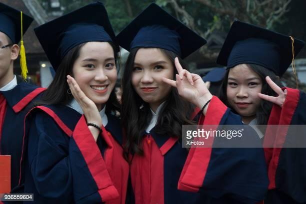 proud high school graduates of hanoi - vietnamese culture stock pictures, royalty-free photos & images