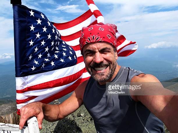 Proud Hiker Flies Flag in Fierce Winds