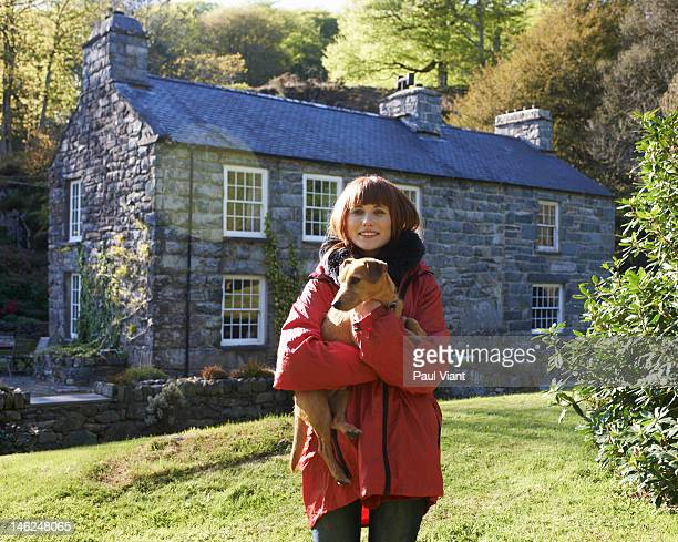 proud home owner with pet dog - cottage stock pictures, royalty-free photos & images
