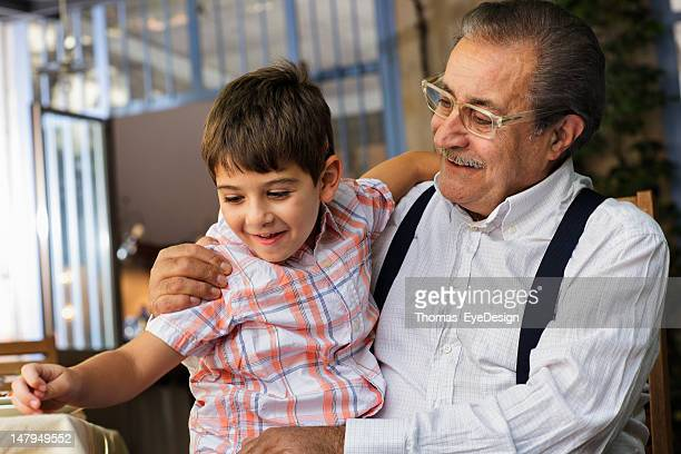 Proud Italian Grandfather plays with his grandson