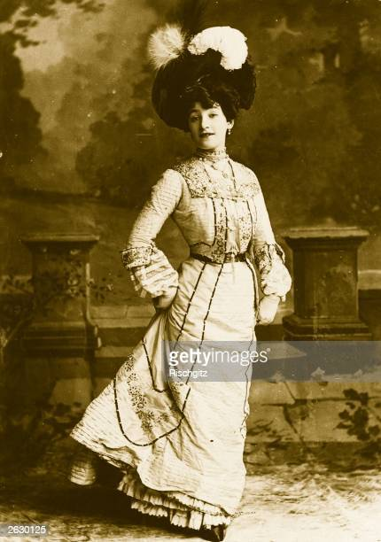 Proud lady in Edwardian street dress, looks lively for this studio portrait.