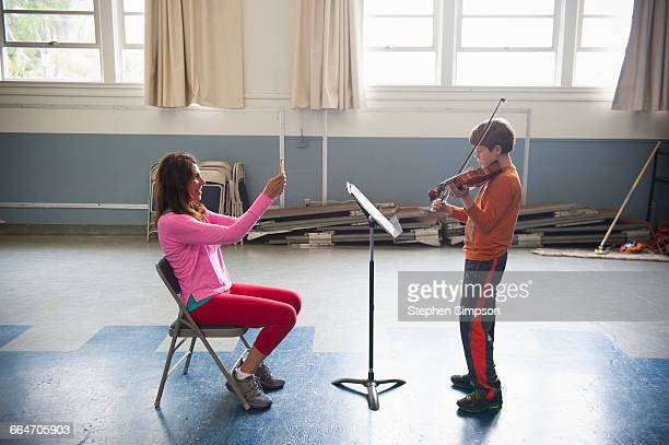 proud mom and her novice violin student