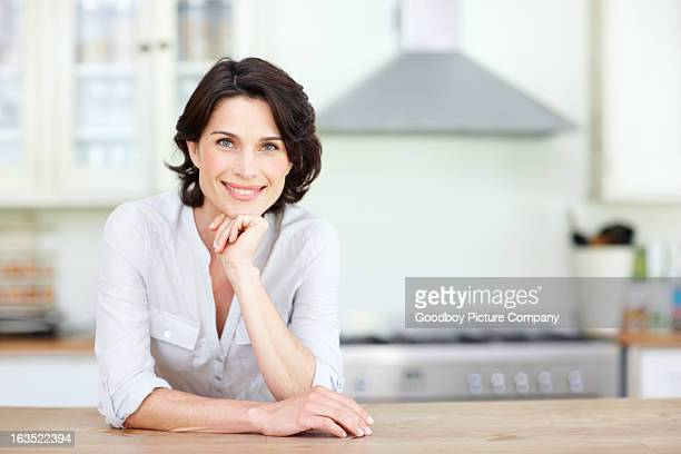 proud of her kitchen - brown hair stock pictures, royalty-free photos & images
