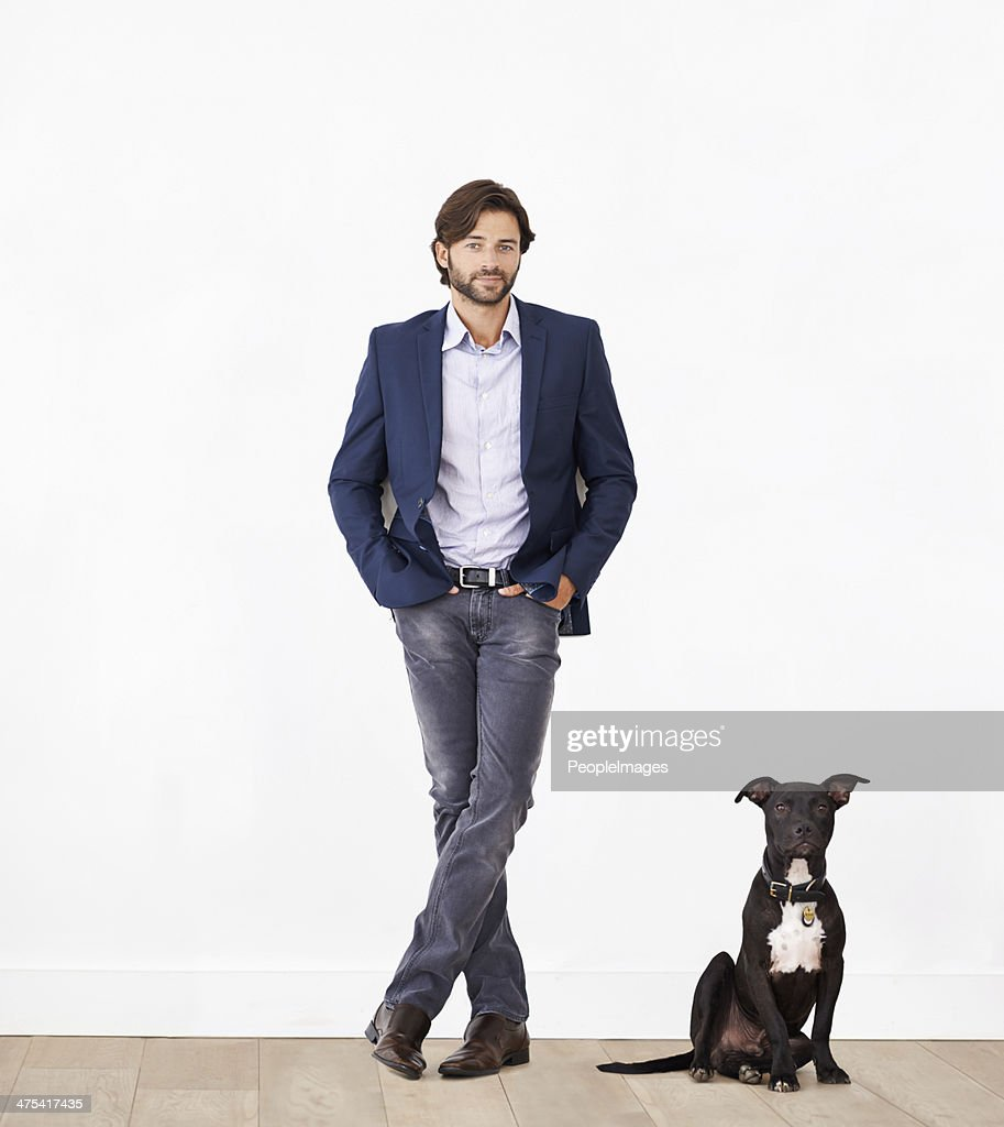 Proud of his canine sidekick : Stock Photo