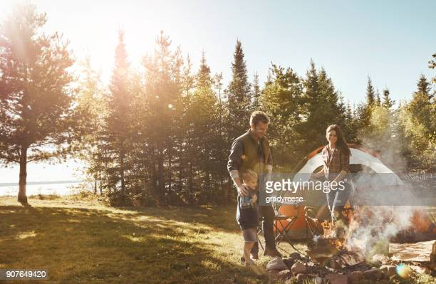 proud of the fire dad created - camping stock photos and pictures