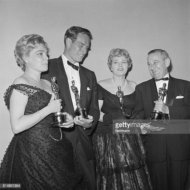 Proud Oscar winners bean here as they hold their trophies after the ceremony late April 4th Left to right Simone Signoret Best Actress Room at the...