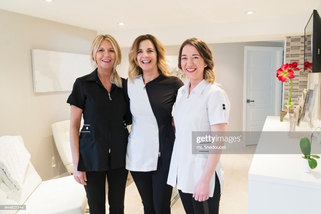 Proud owner and co-workers of a beauty spa. : Stock Photo